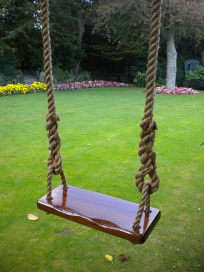 Children's swing, using reclaimed mahogany and natural manila rope.
