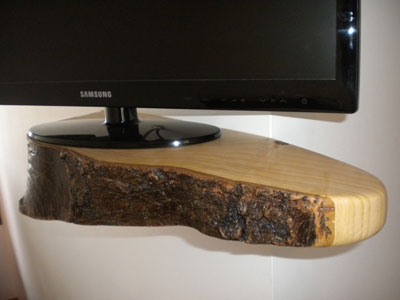 Wall mounted tv shelf in lime wood.